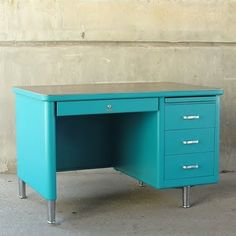 Teal Steelcase Tanker Desk..  I'm in love with these desks.  I want to paint mine this color but husband is objecting!