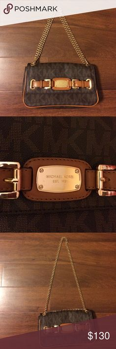 """Michael Kors Purse Michael Kors Purse brown with gold hardware. Clean and in excellent condition Slip pocket in back. Zipper inside pocket with credit card holder slots other side has a slit pocket purse is about 10"""" by 5"""" with a 15"""" handle or if doubled chain it's 9"""" Michael Kors Bags Shoulder Bags"""