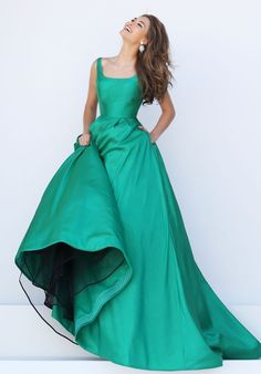 Simple long prom dress features tulle underskirt in a-line satin skirt, topped with sleeveless v-back bodice. Colored in emerald green.