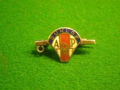 Dunlop ARP pin badge.  Silver and enamel ARP badge for the Dunlop Rubber Company. Marked \' solid silver \' to the reverse. Small enamelled shield mounted on a tie bar style fitting in excellent condition with undamaged enamel.