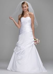 This beautiful satin bridal gown is draped and pleated to create a stunning sculptural look.   The flattering shape is enhanced by a pleated surplice sweetheart neckline and slight dropped waist.  Side draped skirt features pick-up details on front and back, with beaded floral embellishment at waist.  Floor length. Available in White or Ivory. Fully lined. Back zip. Dry clean.  Available in Plus as style 9SAS1203.  To preserve your wedding dreams, try our Wedding Gown Preservation Kit.