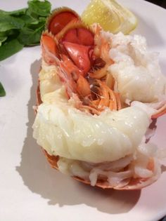 How to Cook Lobster Tails - Bring a pot of water to a boil and add a pinch of salt. Add the lobster tails. Simmer then until they are done. Count on them taking between 4 and 10 minutes depending on size. When the shell changes color and the meat turns from glossy to opaque, the tails are ready. Let them cool for 5 minutes, then use sharp scissors to cut down the shell, so you can pull the meat out. Put the meat back in the shell and serve with the melted butter and lemon wedges.