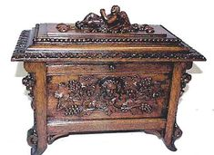 This antique oak box from France, with intricately carved grapes, is the ideal repository for corkscrews and other utensils in a wine cellar or wine room