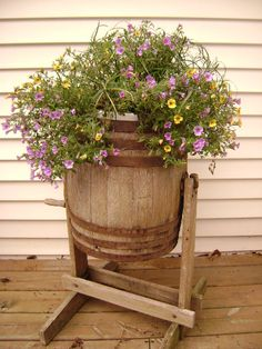 Old Barrel...stuffed with flowers. (It's actually an old butter churn. I have one sitting in my kitchen.)