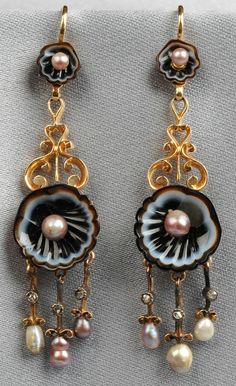 Antique Agate, Pearl, and Diamond Earpendants, c. 1870, each designed as carved agate oyster shells centering seed pearls and joined by scrollwork, suspending a diamond and pearl fringe, gold mount, lg. 2 in., maker's mark.     Descended in the family of William and Henry Walters, who established Baltimore's Walters Art Museum. At Skinner.