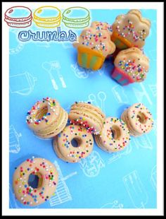 Doughnut / Donut Macarons & Cupcake Macarons!    Check out more here:  http://www.facebook.com/crumbs.macaron
