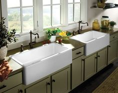 Kitchen with sage green cabinets and Porcher® fire clay London™ Farm Sinks (apron-front/farmhouse sink)