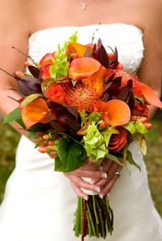 rustic orange calla lilies with pincushion protea for a fall bride