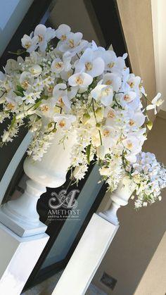 All white wedding urn orchids arrangement