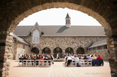 Spring Wedding Northern Michigan Castle Farms nautical theme Amber + Joe photo by Paul Retherford Wedding Photography, http://www.paulretherford.com in the Queen's Courtyard #northernmichigan #wedding #puremichigan #destinationwedding #castlewedding #lovelyday #springwedding #bride