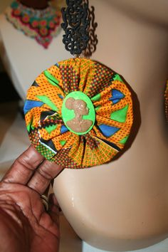 Hey, I found this really awesome Etsy listing at https://www.etsy.com/listing/191203998/green-orange-kente-yo-yo-earring-wedding