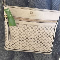 "Kate spade cross-body - perri lane bubbles - beige Kate spade cross-body purse. This cute, versatile purse is perfect for the summer! It is approximately 10"" long and 9"" tall and 1"" wide. It is a cream/beige color, so it will coordinate with all your summer outfits!! The long strap is adjustable so you can custom fit it to your body. kate spade Bags Crossbody Bags"