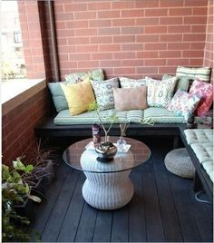 This could be cozy at one end of the balcony. Easy enough to have a bench built and covered with pillows.