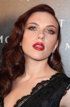 Love this vintage inspired look on Scarlett Johansson. Red Lips, Glittery eyes and perfect cashmere and contoured skin!
