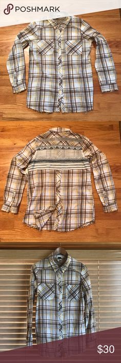 """Free People Plaid Button Up Shirt Long sleeves with double button cuffs. 2 chest pockets. Frayed edges. Floral peek-a-boo lining at collar and shoulders. Lower back snaps allow you to open it up. Really cool back aztec print knit and woven detail across back shoulders. Adds a ton of interest and texture. 92% cotton / 9% acrylic. L - Shoulder to bottom hem: 30"""" / Sleeves – 25"""" shoulder to cuff. Chest – 20"""" armpit to armpit. Worn a couple times. ✨Fantastic condition.✨ Free People Tops Button…"""