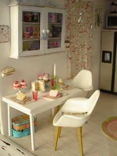 miniature kitchen with Eames style chairs