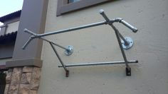 Outdoor pull up bar done by idyllic creations. .. retro - nouveau