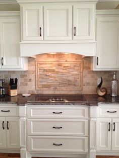 Custom kitchen cabinetry, travertine and ledger stone backsplash, granite countertops and accessories.