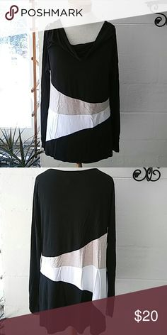 """WHBM tunic Turn some heads in this beautiful tunic made of 95% rayon. Bust 36"""" length 30"""". High low style 3"""" shorter in front. White House Black Market Tops Tunics"""