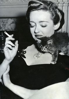 Bette Davis with Lonesome the kitten, April 1943.