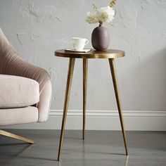 "Tripod Side Table, Antique Brass, $129, 15""diam. x 22""h."