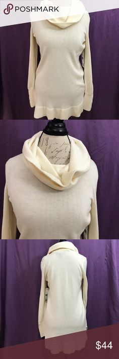"NWT Ralph Lauren cowl neck sweater Cozy cream colored sweater with cowl neck. 4"" slits on bottom of each side. Armpit to armpit: 20"". Shoulder to hem: 31"". Lauren Ralph Lauren Sweaters Cowl & Turtlenecks"