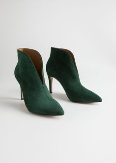 a9cb620268f4 Feminine suede boots offering a chic front cut and a thin stiletto heel.