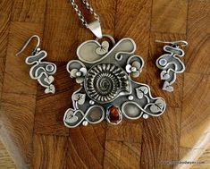 Louise O'Dwyer ammonite pendant and matching earrings