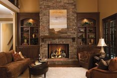 Fireplace with different stone. have stone go to ceiling. windows next to fireplace then built ins with base cabinets from wall to fireplace by delia Fireplace Bookshelves, Fireplace Built Ins, Home Fireplace, Fireplace Remodel, Fireplace Design, Bookcases, Fireplace Ideas, Corner Stone Fireplace, Library Fireplace