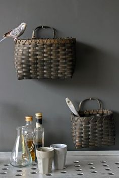 Have a small space? Hang these baskets on the wall for easy storage!