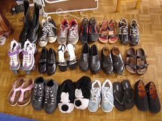 """I was invited to join the """"pictures of our shoes"""" group, which involves taking a picture of all your shoes and commenting on them. And so, I did.     Athletic and Outdoor shoe store opens the door to active life. Our lineup of athletic shoes equips the novice runner looking for the best pair of sneakers and the seasoned pro looking for the latest in performance enhancing athletic shoes."""