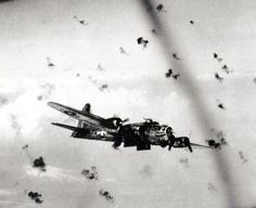 """A B-17 bomber flying through flak (anti-aircraft fire) on a mission over Nazi-occupied Europe. In """"A Memory Between Us,"""" pilot Maj. Jack Novak is injured by flak on his first mission from England."""