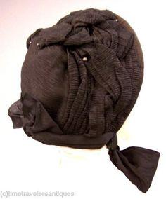"""...mourning bonnets .... trimmed in folds of black crape."""