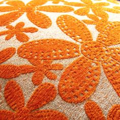 Orange floral fabric. Love the texture.