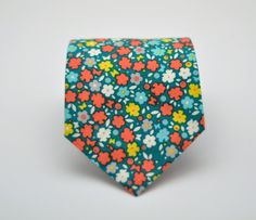 Hey, I found this really awesome Etsy listing at https://www.etsy.com/listing/209363466/mens-floral-necktie-teal-and-orange