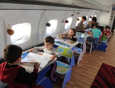 Upcycled plane converted to kindergarten classroom. Of course this is not in the US.