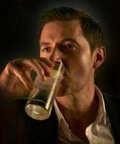Daniel drinking gin and tonic
