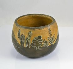 I love this old terra cotta Mexico clay pot. From the Tlaquepaque region. Mexican folk art. Hand painted with a Senor taking a siesta among the yucca , cactus and mountains. There is even a barn! Measures 3 1/4 tall with a 4 diameter. Has a hole in the base for drainage. Perfect for a succulent or cactus! Please see all 5 pictures as they are part of the description. There is also a zoom feature! For more fun and fabulous curiosities check here: www.chicmousevintage.etsy.com Rocks, fake...