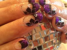 Black tips with glitter fade and flower freehand nail art over acrylic nails