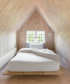 Photo 15 of 18 in Here's How to Put Your Bed on the Floor Without it Looking Sloppy from A Radiant Remodel Revitalizes a Dark Seattle Tudor House - Dwell Sleeping Nook, Plywood Interior, Exclusive Homes, Tudor House, Built In Bench, Queen Anne, Modern Bedroom, Home Renovation, Seattle
