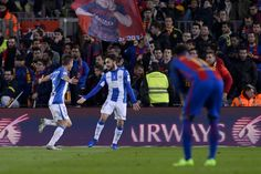 Leganes' midfielder Unai Lopez (R) celebrates his goal with Leganes' defender Alberto Martin during the Spanish league football match FC Barcelona vs CD Leganes at the Camp Nou stadium in Barcelona on February 19, 2017. / AFP / Josep Lago