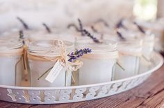 Mother made candles from Maman jam jars. Lavender-scented? Sprig attached. Nice presentation.