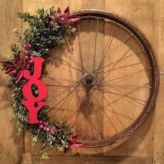 Pin for Later: 39 Strikingly Unique Holiday Wreaths Bike tire Bicycle Crafts, Bike Craft, Bicycle Decor, Bicycle Rims, Bicycle Wheel, Bike Wheels, Wagon Wheels, Bicycle Art, Holiday Wreaths