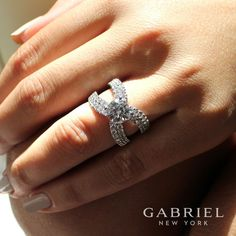 Gabriel NY - Preferred Fine Jewelry and Bridal Brand. 18k White Gold Round Split Shank Engagement Ring.. In this spellbinding engagement ring, a dramatic split shank is illuminated by multiple tiers of shimmering pave diamonds. Find your nearest retailer-> https://www.gabrielny.com/storelocator