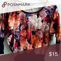 Floral Top This shirt is floral with beautiful colors. It is looser on the top and gets tighter on the bottom of the shirt and around the sleeves. 3/4 sleeves. Tops