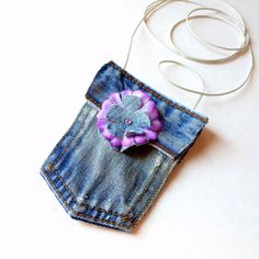 20 Ways To Repurpose Your Old Jeans - I'm thinking with a strap of some kind this would handy for my iPod when I don't have any pockets.