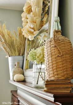 http://www.atthepicketfence.com/2014/09/fall-home-tour-fall-decorating-ideas.html  Love the layers in this fall mantel
