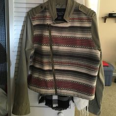 New without tags American eagle jacket New without tags American eagle jacket, size XL. Olive green with multi color design. Zip up. Button on sleeves. American Eagle Outfitters Jackets & Coats