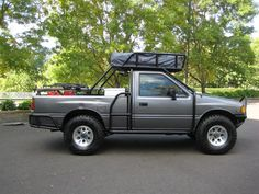 Here's a very nicely equipped, relatively low mileage, Isuzu Pickup that's ready for any off-road adventure. It has a full exoskeleton and rack, Old Man Emu suspension, a winch… Truck Roof Rack, Truck Tent, Truck Camping, Jeep Pickup Truck, Custom Pickup Trucks, Grand Vitara, Pick Up, Accessoires 4x4, Motorhome