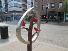 This adorable sculpture on Sheridan. I don't know who made it.